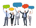 Business People Holding Colorful Speech Bubbles Stock Photography - 50764532