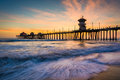 Waves In The Pacific Ocean And The Pier At Sunset  Stock Image - 50769611