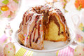 Ring Cake With Icing And Chocolate Glaze On Easter Table Royalty Free Stock Photo - 50770385