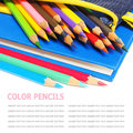 Colour Pencils And A Blue Note Book Isolated On White Stock Image - 50780601