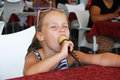 Young Girl Outdoors Eating Ice Cream Royalty Free Stock Photography - 50801887