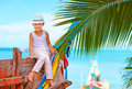 Cute Fashionable Boy Posing On Old Boat At Tropical Beach Royalty Free Stock Image - 50815526