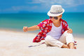Stylish Kid, Boy Playing With Sand On Summer Beach Royalty Free Stock Photos - 50853598