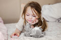 Little Girl In Bed Playing With Its Teddy Bear Royalty Free Stock Images - 50865469