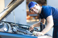 Car Mechanic Working In Auto Repair Service. Stock Images - 50879684