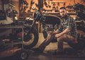Mechanic Building Vintage Style Cafe-racer Motorcycle Stock Photos - 50887373