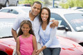 Family On New Car Lot Royalty Free Stock Image - 5096486