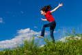 Girl Jumping Outdoor Stock Image - 50910581