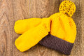Yellow Knitting Cap And Mittens Stock Image - 50951751