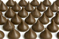 Chocolate Drops In Rows With Only A Few Rows In Focus. Stock Images - 50953434