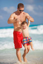 Young Father With A Young Son Play Near The Ocean. Royalty Free Stock Image - 50957376