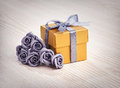 Grey Flowers And Golden Gift Box Royalty Free Stock Photo - 50959745