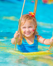 Happy Girl On Water Swing Stock Images - 50963724
