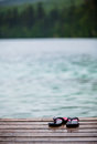 Flip Flops On A Dock In Front Of A Turquoise Water Lake Stock Images - 50967274