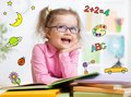 Funny Smart Kid In Glasses Reading Book In Stock Photography - 50968692