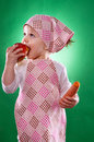 The Baby Girl With A Kerchief And Kitchen Apron Holding An Vegetable Isolated Stock Image - 50979191