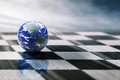 World On A Chessboard  On Blue Sky Background Stock Photography - 50992622