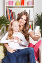 Happy Woman And Child Taking A Selfie Stock Photo - 51004300
