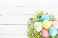 Wicker Nest With Easter Eggs Royalty Free Stock Images - 51027319