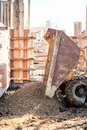 Dumper Truck Unloading Construction Gravel, Granite And Crushed Stones At Building Foundation Stock Photos - 51031133