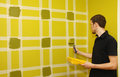 Man Painting Wall With Masking Tape Stock Photography - 51045002