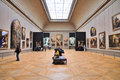 Tourists Look At The Paintings At The Louvre Museum Stock Images - 51048264