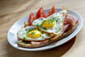 Bread With Ham And Fried Egg Garnish With Chives On A Plate Royalty Free Stock Photos - 51065138