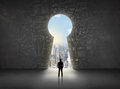 Business Man Looking At Keyhole With Bright Cityscape Concept Stock Photography - 51068042