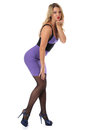 Young Woman Wearing Tight Purple Short Mini Dress Blowing A Kiss Stock Images - 51073914