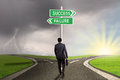 Entrepreneur With Signpost To Success Or Failure Stock Photo - 51118840
