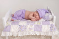 Baby Girl Sleeping On A Little Bed Stock Photography - 51120952