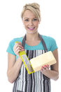 Attractive Young Woman Grating Cheese Stock Photos - 51123403