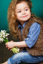Beautiful Little Girl With A Big Bouquet Of Snowdrops. Royalty Free Stock Photos - 51142908