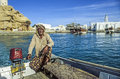 Arabic Ferry Man Transports Passenger In An Old Traditional Boat Stock Photo - 51177020
