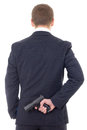 Man In Business Suit Hiding Gun Behind His Back Isolated On Whit Royalty Free Stock Photo - 51180885