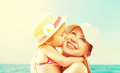 Happy Family On Beach. Baby Daughter Kissing Mother Stock Photography - 51186542