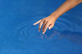 Woman Hand With Perfect Manicure Playing With Water In A Pool Royalty Free Stock Image - 51186596