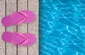 Swimming Pool, Wooden Deck And Pink Beach Shoes Royalty Free Stock Photos - 51188738