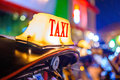 Thai Taxi (Tuk Tuk) Sign With Defocused Lights Blur , Chiang Mai Royalty Free Stock Photography - 51193137