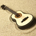 Spanish Guitar In The Sand Royalty Free Stock Images - 51198539