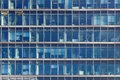 Glimpse Into The Workplaces Of An Office Building With Blue Glas Stock Image - 51205031