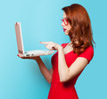 Surprised Redhead Girl With Laptop Stock Image - 51206401