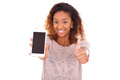 African American Woman Showing A Mobile Phone And Making Thumbs Stock Image - 51209101