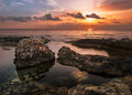 Sunset Over The Sea And Rocky Coast With Ancient Ruins Stock Image - 51210151