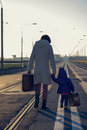 Lovely Girl And Mother With Suitcase On The Railway Leaving Stock Photography - 51212212