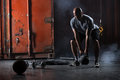 Bald Charismatic Athlete Doing Squats With Weights Stock Image - 51215911