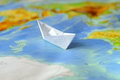 Paper Boat On A Background Map Of The World Stock Image - 51222011