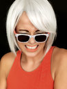Attractive Young Woman Embarrassed Wearing Sunglasses Royalty Free Stock Photos - 51225018