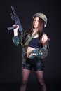 Beautiful Young Woman In A Military Uniform With A Submachine Gu Royalty Free Stock Photography - 51254747