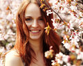 Happy Young Woman In Spring Flowers Garden Stock Photo - 51257270